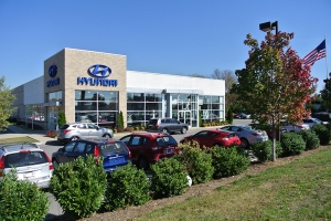 A diagonal view of a Hyundai car dealership where Rains Electric Company installed commercial lighting.