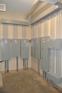 Vertical image of a 6-panel electrical upgrade for a commercial wiring project.